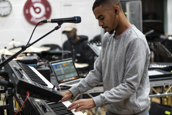 Swindle playing the piano