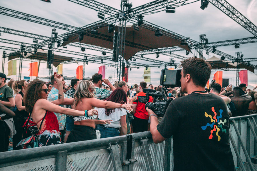 festival goers having fun dancing in front of the camera.